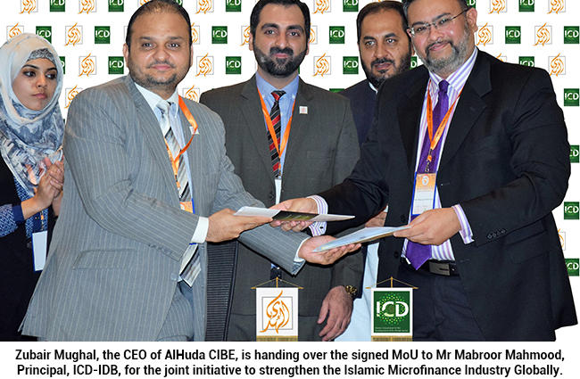 Zubair Mughal, the CEO of AlHuda CIBE, is handing over the signed MoU to Mr Mabroor Mahmood, Principal, ICD-IDB, for the joint initiative to strengthen the Islamic Microfinance Industry Globally.